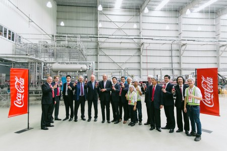 Ambassador Daniel A. Clune celebrating the official opening of Coca-Cola's new bottling plant in Vientiane.